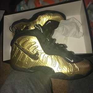Black And Gold Nike Foamposite size 4.5y